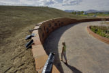 DLM1746  Kirsten Kreiling, a member of the Columbine Memorial Committee, walks around the outer...