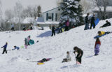 Kids off from school in  Littleton enjoy a snow day off from school by playing in the snow at...