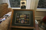 Exceptionally well decorated, his medals would not all fit in this case. His son says he qualifies...