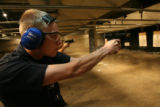 Denver Police Officer Robert Suthern, (cq), takes aim and fires at his target withi fellow...