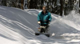 (EVERGREEN, Colo., April11, 2005) Joe Schoen (cq) works on clearing heavy wet snow from his...