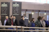 Denver, Colo. April 11,2005 . People wait in the ticketing line at DIA on Monday (4-11-2005). The...