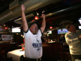 Steve Steadman, (cq) of Centennial and Dave Price, (cq) of Denver cheers in the top of the 4th...