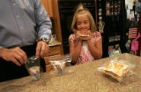 Randy Vier (cq) puts his daughter Olivia's (cq), 8, grass in a plastic baggie in the kitchen of...