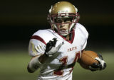 Faith Christian senior running back Andrew Tycksen runs the ball for a first down in the third...