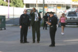 PIO Detective John White, center with suit and tie, helps with investigations on the scene of the...