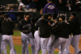 Colorado Rockies celebrate after beating the Phillies 2-1, completing their sweep of the Phillies...