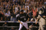 [ES0875] Seth Smith celebrates after sliding into home to score on a sacrifice fly by Kazuo Matsui...