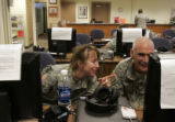 Colonel Karen Weldon (cq), left, works with her friend Lt. Colonel Michael Patrocky (cq) on...