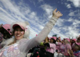 Debra Ordway (cq), from Boulder and a twelve-year breast cancer survivor, waves to the huge crowd...