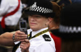 Police officer Heather Wright (cq) from Lincolnshire England takes a shot of her fellow officers...