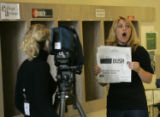 0295 Colorado State University News anchor Carri Wilbanks reacts to a friend in the hallway while...