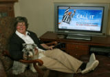 Suzy Olmsted (cq), and her dog, Riley, with her fiber connection to her TV, from Qwest, Monday...