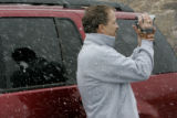 Kevin Duty (cq) from Austin TX, takes some video of the sleet and snow at Horseshoe Park in Rocky...