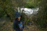 Lorenzo Holt (cq), 5, stands near where police found a body believed to be that of Niveah...