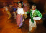 Dancers Rita Figueroa (left) and Alfredo Granillo (right) dance during the Celebrate Dia de los...