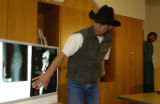 Dr. Michael Sisk, Orthopedic  Surgery, talks about the x-rays of  Charles Horton at the Yampa...