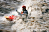 (DENVER, Co. - SHOT 4/11/2005) Steve Phillips, 31, of Denver surfs a standing wave at Confluence...