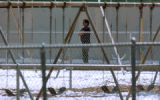 (DENVER, Colo., Apr. 12, 2005) A Denver Police  officer watches the playground area of valverde...
