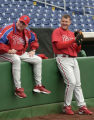 PHILS27--2/26/05--PHOTO BY MICHAEL PEREZ--Phillies manager Charlie Manuel and Jim Thome taking a...