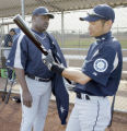 030205 Mariner hitting coach Don Baylor, left, talks to Ichiro Suzuki about the leadoff hitters...