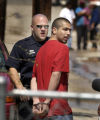 Denver Colo.-April 12 ,2005-   A man is arrested by Denver Police at 386 S. Decatur Street on...