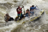 (BUENA VISTA, Colorado... June 9, 2004) White water  guide Ernie Hatfield rows his boat through...