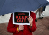 Amy Durfee West, Denver, joins a rally outside the Alfred A. Arraj U.S. Courthouse in Denver on...