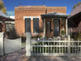 The exterior remodel of Mike Webber's home included stripping layers of paint off the brick,...
