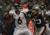 JPM012 Denver Broncos Jay Cutler is rushed by New England Patriots Richard Seymour on his first...