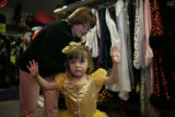 Maya Thomas, 3 (cq) tries on a belle Halloween costume from Beauty and the Beast inside Marcia's...