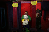 Randy Blea (cq) tries on a mardi gras court jester costume inside Marcia's Costumes, 5368 Sheridan...