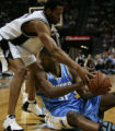 Denver Nuggets Nene, right, tries to keep the ball away from San Antonio Spurs Robert Horry,...