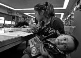 (DENVER, COLO.,  MARCH 16, 2005)  Daisy,19, A senior at Lincoln High School, holds her...