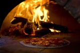 Pizza bakes in the wood burning oven at Parisi on Oct. 30, 2008 when Eat drink shop visits Berkley...