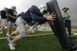 DM3501  Colton Farley and other players of the Valor Christian offensive line push coach Rex Rolf...