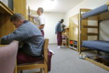 DM3976  Ridge View Academy quarterback Jeffrey Duff, left, sits a desk in his dormitory room as...