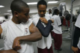 DM4226  Ridge View Academy players Quincy Tate, left, and Gilbert Robertson compare biceps as the...