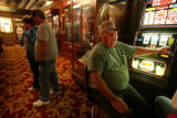 Ryan Soderlin/Journal staff Ron Osban of Manderson, Wyo., smokes and gambles at the Celebrity in...