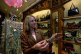 Pam Delazano holds one of the charm bracelets that she has decided to buy at the Brighton...