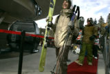 Skiers and riders who waited in line walk the red carpet as  Keystone Ski Resort not only opened...
