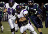 Jose Astorga turns up field against ThunderRidge in the first half  on Friday, November 7, 2008...