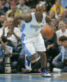 BG153 Denver Nuggets Chauncey Billups touches the ball for the first time as he makes his second...