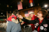 (CS047) Sandi Sugden, right, pets Kitty who wears a McCain Palin shirt before Republican...
