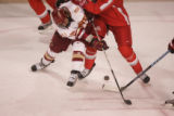 #14 Jesse Martin (cq) of Denver fights for the puck as the Denver Pioneers take on the Ohio State...