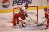 #19 Kyle Ostrow (cq) scores Denver's third goal as the Denver Pioneers take on the Ohio State...