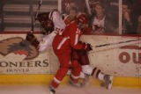 #5 John Lee of Denver is smashed into the wall by #26 Peter Boyd of Ohio St., as the Denver...