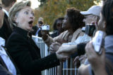 Sen. Hillary Clintons reacts to one of her fans as she presses the flesh after speaking at an ...