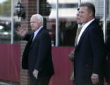 (CS123) Republican presidential candidate John McCain walks out with John Lynch and John Elway at...