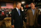 (CS463) John Elway and John Lynch laugh after speaking on behalf of Republican presidential...